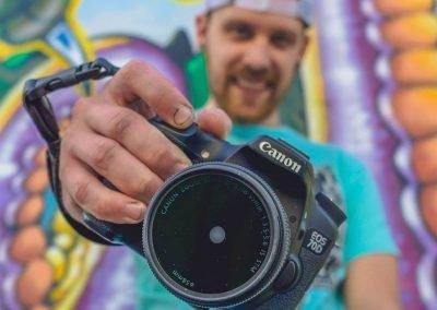 justin hallberg headshot with canon camera