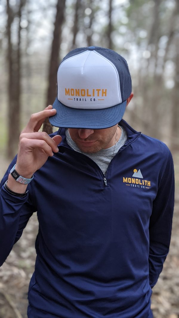 cory logsdon in the monolith foamie trucker hat and spring quarter zip