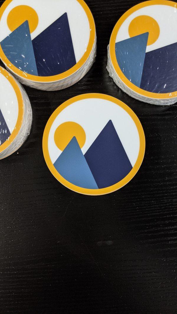 pile of monolith trail co brandmark circle sticker