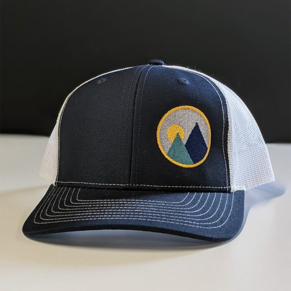 product shot of monolith trail co trucker hat