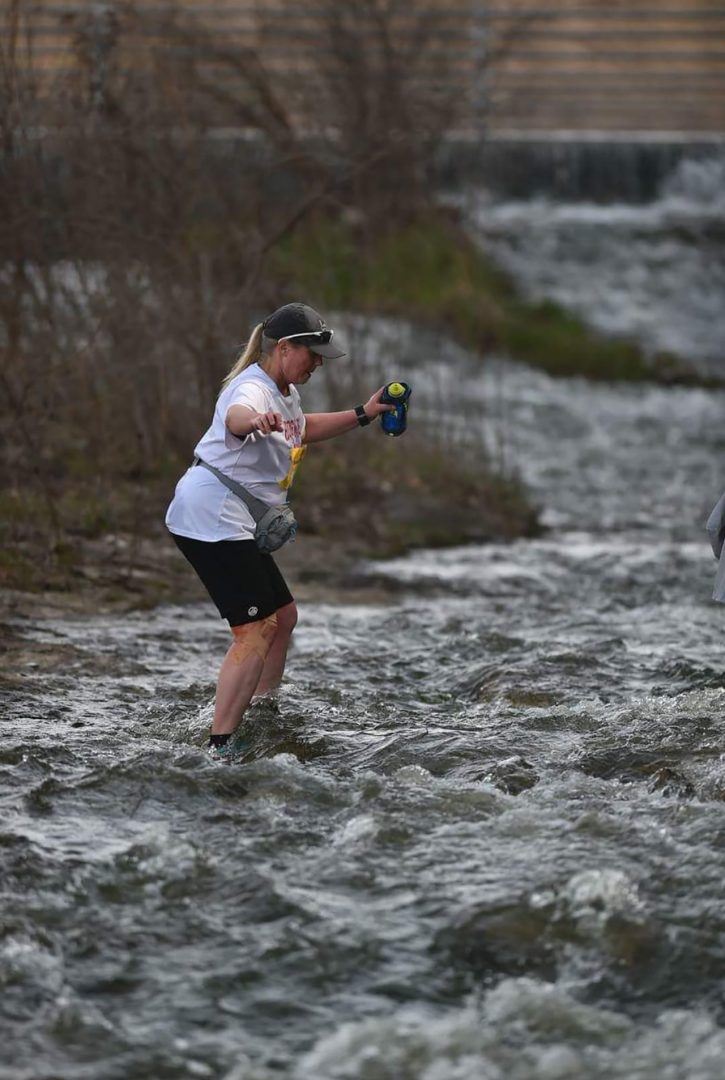 shawn naeve running a race through a deep stream