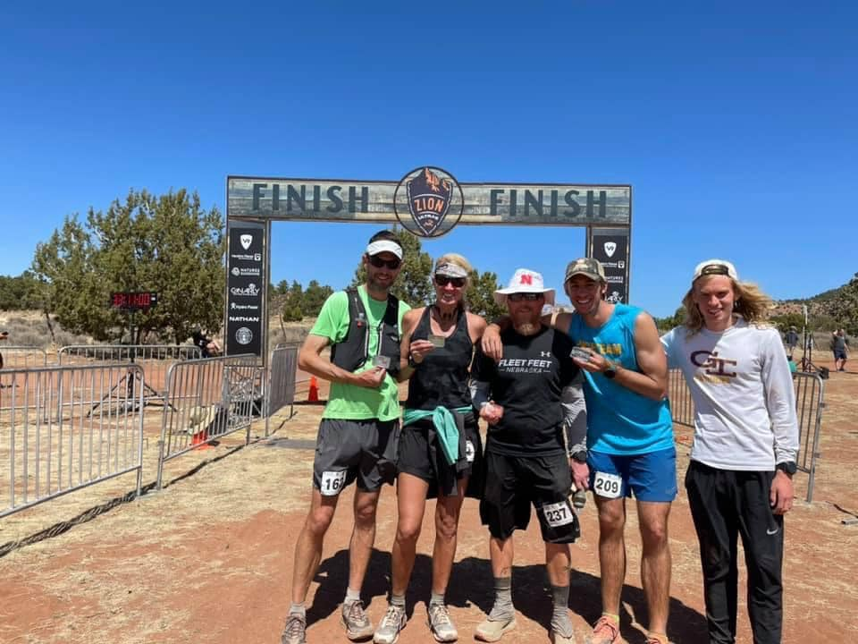 jeff morrick and friends at the finish of the zion 100 mile trail race