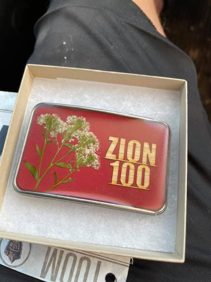photo of jeff morrick's custom zion 100 mile belt buckle